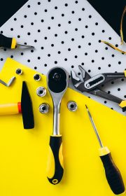 Yellow set of tools on black and yellow background